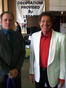 Ryan Land, sports editor, poses for a photo with Barry Williams at the annual Joplin Busniess Expo on Jan. 22.
