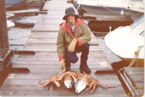 Proudly displaying catch of the day—a giant crab—while living in Alaska.