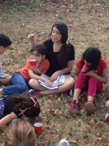 Photo contributed Thalia Jimenez, criminal justice major, reads to children during the backyard Bible study in Memphis, Tenn. that took place over spring break.