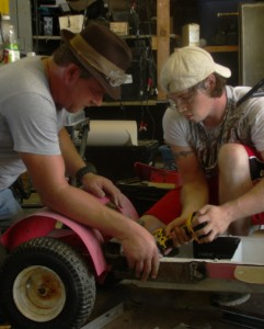 James Walls |Editor-in-Chief Chris Catron, president of Solar Green, and Philip Wilson, solar energy major, work on a solar go-kart on Sept. 6, 2013 at the old solar lab on the Neosho campus.
