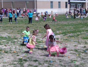 Photo Contributed Children in the age group of 3-5 hunt for eggs during Phi Beta Lambda's annual Easter Egg Hunt that was held on April 19 on the Neosho campus..