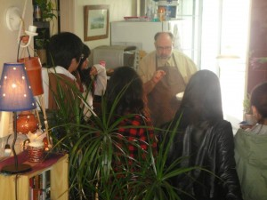 Mark Shryock teaches an ESL class on cooking spaghetti to a class of college students in Korea.