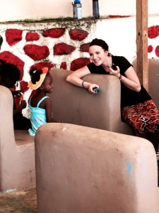 Haley Perkins, a sophomore Criminal Justice major, laughs with a Haitian student in Port-Au-Prince, Haiti.