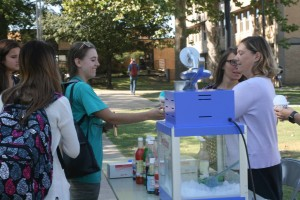 Students receive snow cones during Wellness Week, an event to promote campus health